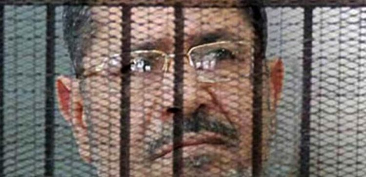 Egypt's ex- President Morsi dies during trial session, Egypt TV says