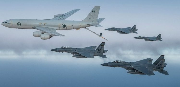 Royal Saudi Air Force F-15C Eagles fly in formation with a U.S. Air Force F-15C Eagles